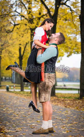 bavarian couple in tracht in loving