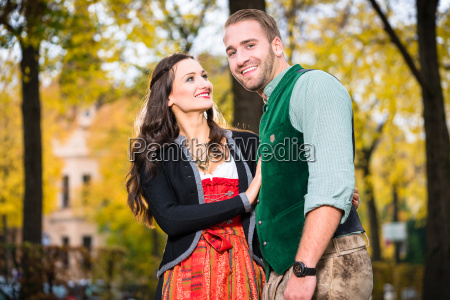 happy couple with tracht in bavaria