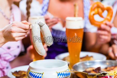girls in bavarian restaurant having breakfast