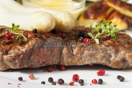 white asparagus on a grilled steak