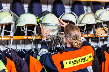 female fire fighter in the locker