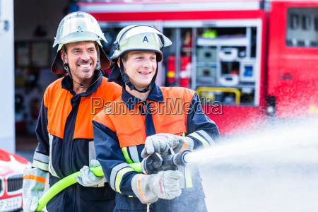 men of the fire department extinguish