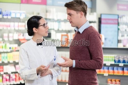 young man reading the prescription of