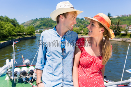 happy couple on river cruise wearing