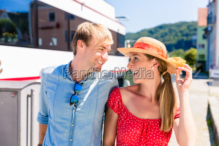 couple on river cruise in summer