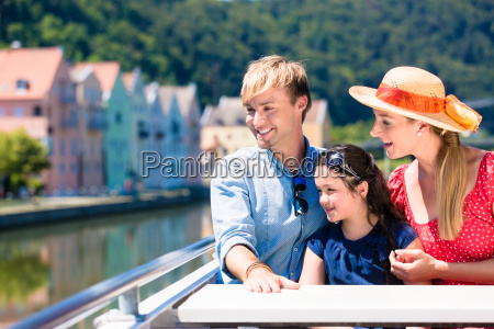 family on river cruise in summer