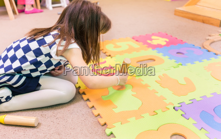 cute pre school girl playing with