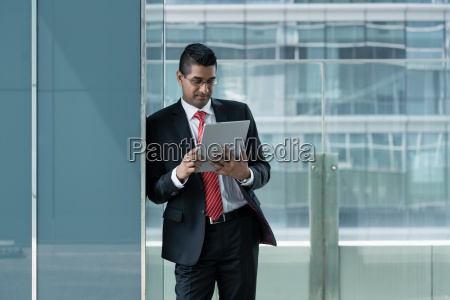 indian businessman using a tablet pc