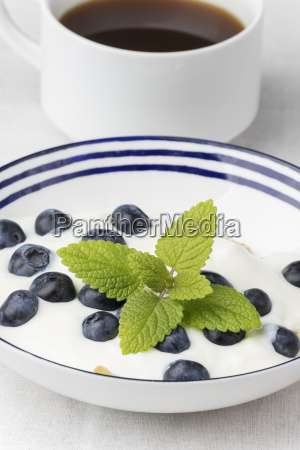 blueberries on yoghurt and coffee