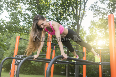 cheerful beautiful woman exercising basic plank