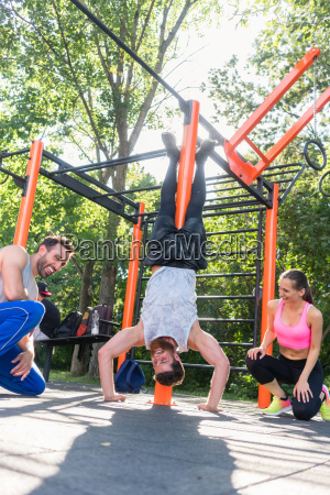 determined young man practicing handstand motivated