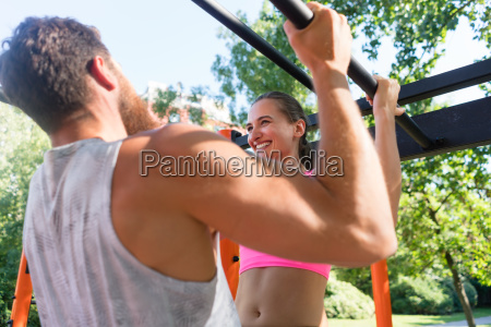 fit young woman doing pull ups