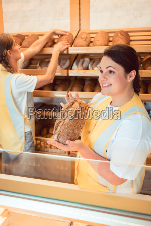 two salesladies selling bread and other