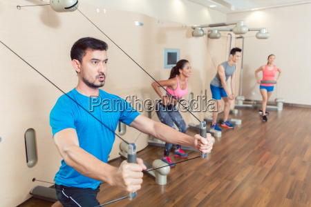 determined young man exercising with resistance