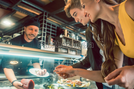 experienced chef choosing raw seafood from
