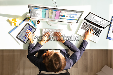 businesswoman doing multitasking work in office