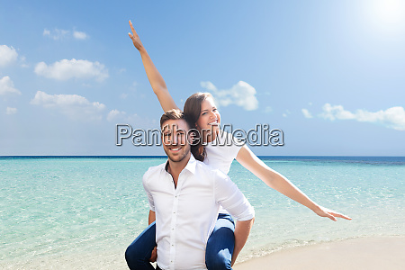 beautiful young couple at beach