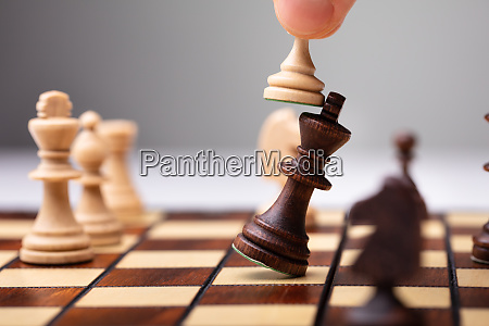 pawn defeating king piece