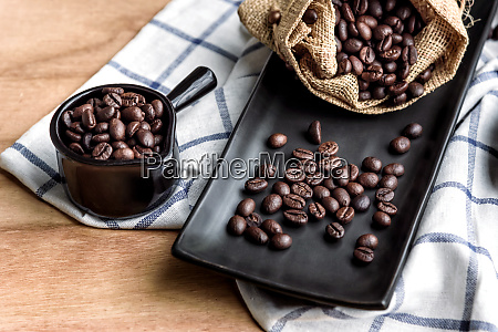 coffee beans in cup and bag