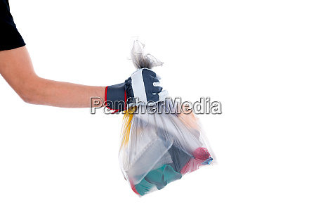 hand with garbage bag with defferent