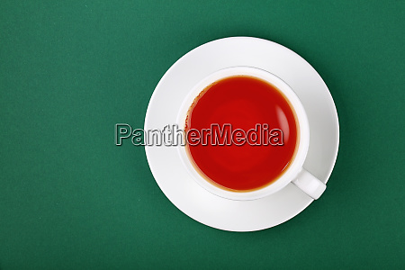 white cup of black tea on
