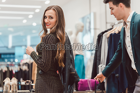 woman trying a new leather jacket