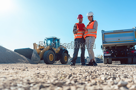 worker and engineer on earthworks construction