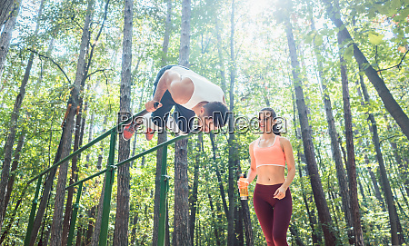 sportive couple doing workout in outdoor