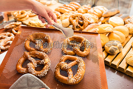 sales lady in bakery shop selling