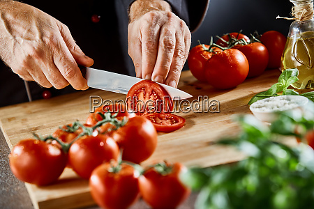 close up on man slicing up