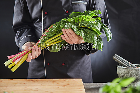 chef holding a bunch of fresh