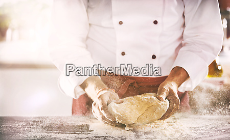 chef or baker preparing a portion