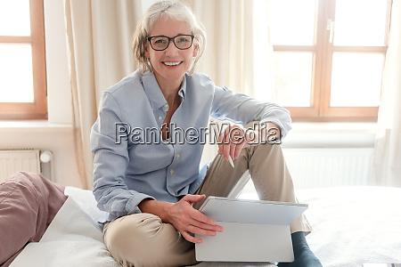 senior woman freelancer in her study