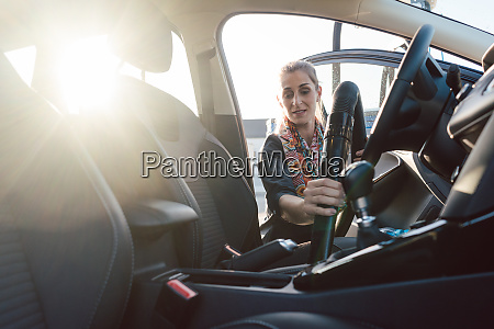 woman cleaning inside of car