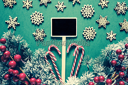 black sign with christmas decoration frosty