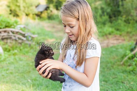 happy little girl with kitten