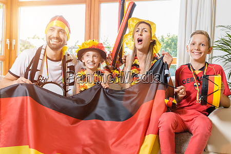 whole family cheering for the german