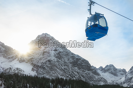 cable car and snow capped mountains