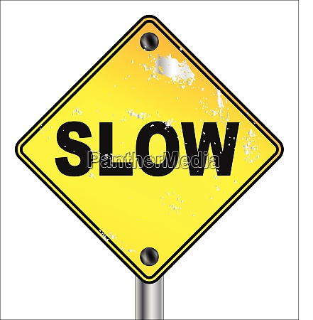 slow yellow traffic sign