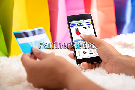 woman shopping online on smartphone