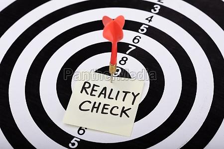 dart and arrow with reality check