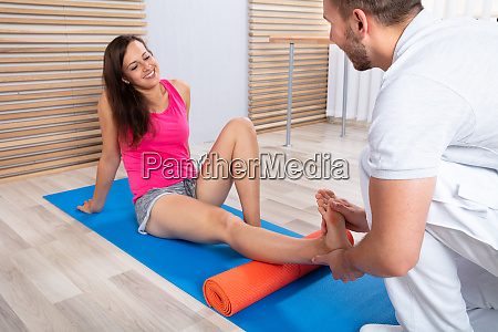 therapist massaging womans feet