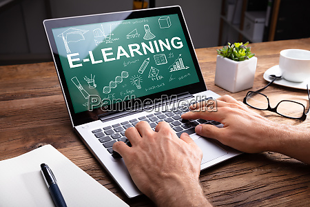person using laptop showing e learning