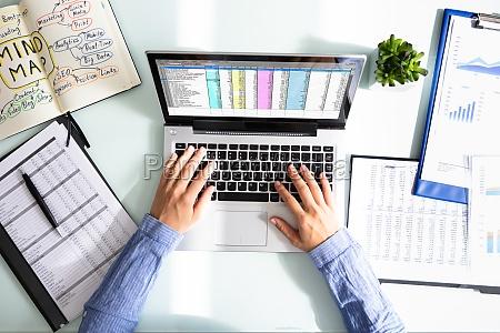 businesswoman analyzing data on laptop