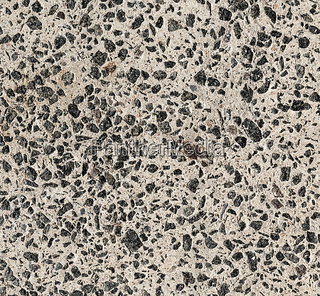 cement texture with small black granite
