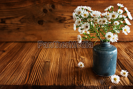 autumen flowers on rustic wood