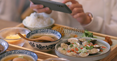 woman taking photo on her dishes