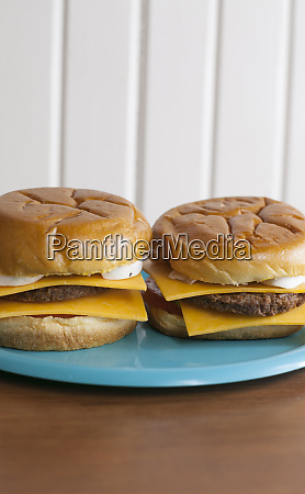 a pair of veggie cheeseburgers on