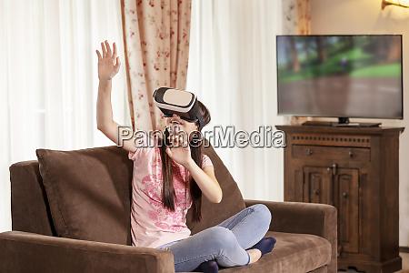 teenager girl having fun with virtual
