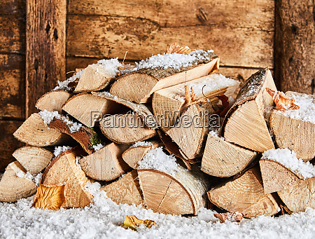 winter woodpile outside a rustic wooden